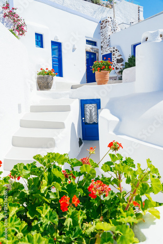 Zdjęcia na płótnie, fototapety na wymiar, obrazy na ścianę : Traditional cycladic whitewashed architecture with blue doors and flower pots, Imerovigli, Santorini island, Greece