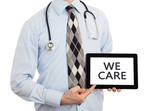 Doctor holding tablet - We care