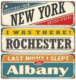 Retro tin sign collection with USA city names