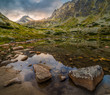 Mountain Lake Above Skok Waterfall with Rocks in Foreground and Strbsky Peak in Background at Sunset. Mlynicka Valley, High Tatra, Slovakia.
