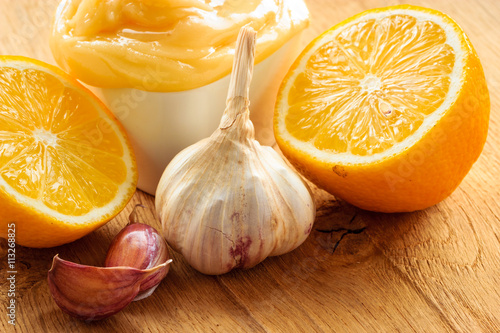 Honey garlic and lemon on wooden rustic table. Poster