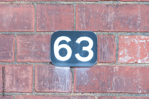 Poster House number 63 sign