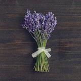 Lavander flowers bouquet on wooden background