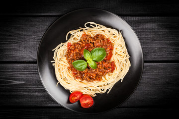 Spaghetti bolognese on dark background
