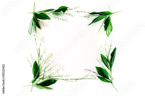 Plexiglas Lelietjes van dalen wreath frame with lily of the valley, branches and leaves isolated on white background. flat lay, overhead view