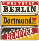 Vintage tin sign collection with German cities