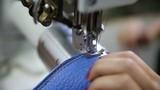 worker hands on sewing machine