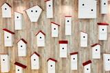 Birdhouses on the wall. Neighborhood and property concept - 113335443