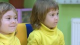 Twins playing with numbers. Four-year-old children in the classroom for intellectual development medium close up