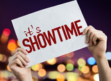 Its Showtime placard with night lights on background