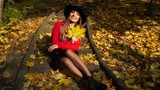 Woman relaxing in autumn fall park steadicam 4K.