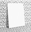 Blank white paper poster leaning at black and white with retro w