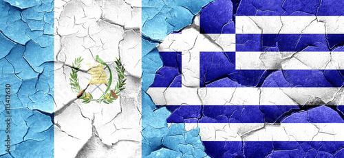 Zdjęcia na płótnie, fototapety, obrazy : guatemala flag with Greece flag on a grunge cracked wall