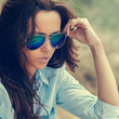 Woman in sunglasses. Outdoor fashion portrait close up