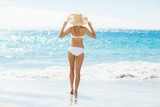Woman in bikini walking on beach