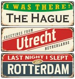 Retro tin sign collection with Netherlands city names