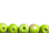 green apples in row - isolated
