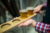 Brewer holding beer sampler tray