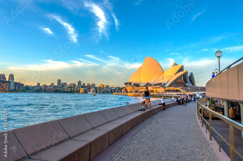 Poster Tourists walking next to opera bar in front of Sydney Opera Hous
