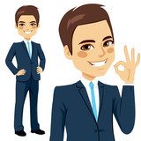 Smiling businessman showing an okay hand sign
