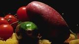 Potato zucchini pasta spaghetti tomatoes cherry chilli seeds on wooden cutting board