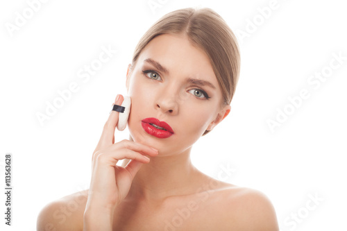 closeup portrait of a beautiful woman with beauty face and clean skin applying sponge © Fresh Stock