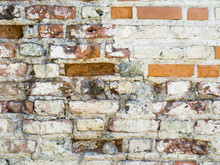 Old red brick wall with sprinkled white plaster texture background