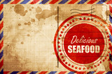 Delicious fish sign, red grunge stamp on an airmail background