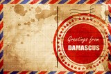 Greetings from damascus, red grunge stamp on an airmail backgrou