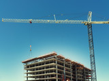 Massive crane assists in construction of high rise development