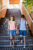 School kids walking on staircase