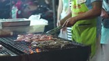 Man Fried Shrimp On The Grill At The Thailand Market