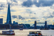 London cityscape with Tower Bridge against a sky with dramatic clouds