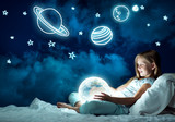Girl in her bed and glowing globe