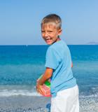 Boy playing ball at the beach