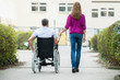 Woman With Her Disabled Husband