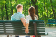 Couple Sitting On Bench Together And Holding Hands