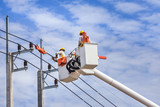 electrician repairing wire of the power line on basket hydraulic lifting platform vehicle