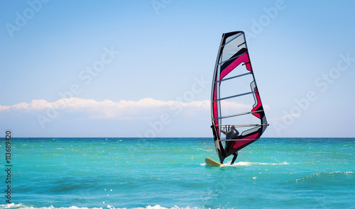 obraz lub plakat Windsurfing sails on the blue sea