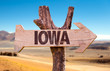 Iowa wooden sign with a desert background