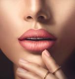Fototapety Perfect woman's sensual lips with fashion natural beige matte lipstick makeup