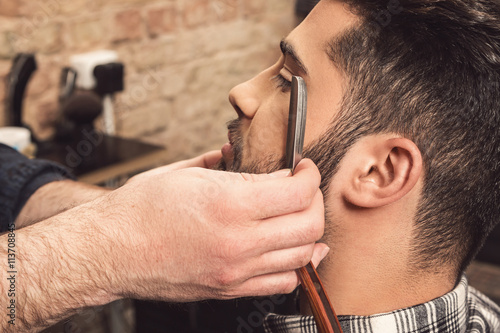 Poster Barber working with a straight razor