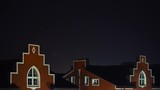 English-slyle rooftops at night, time lapse video