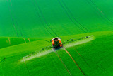 Tractor spraying the chemicals - 113768824