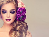 Summer  woman . Beautiful model with flower wreath on his head . Makeup smoky eyes . Summer girl with trendy makeup .