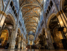 "Постер, картина, фотообои ""12th-century Romanesque Parma cathedral filled with Renaissance art. Its ceiling fresco by Correggio is considered a masterpiece of Renaissance fresco work."""