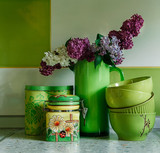 Ceramic Plates and Jars.Tableware,Bouquet of Lilac in the Green Pitcher.Kitchen accessories