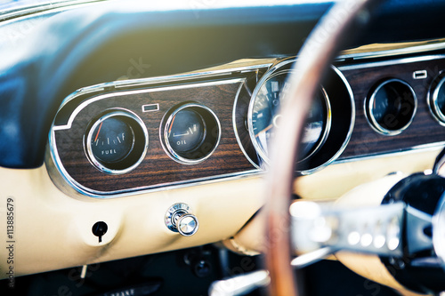 Inside view of classic american muscle car, with focus on dashboard Plakát