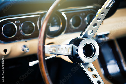 Poster Inside view of classic american muscle car, with focus on steering wheel