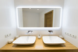 Two moderm sink in the bathroom, and big mirror